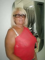 Curvy mature prostitute posing totally naked