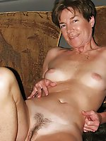 Horny mature dame taking off her clothes