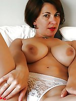 Voluptuous experienced female posing undressed on photo