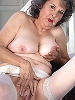 Lascivious older milf in a sex gallery