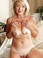 Mature tart taking off her bra