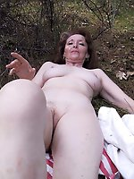 Fantastic older MILF spreading her pussy lips