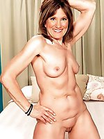 Mature female posing naked in public