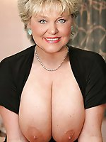 Dissolute older chick getting undressed