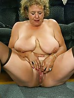 Spicy mature slut spreading her legs