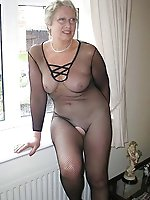 Outstanding older MILF playing with her boobs