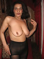 Horny mature whores getting nude on photo
