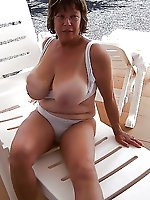 Horny mature tart revealing her hooters