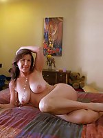 Big breasted older bitch getting nude on camera