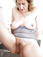 Big breasted older mama posing naked