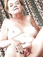 Lascivious older woman showing off her hooters