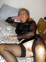 Big breasted mature milf having shaved slit