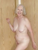 Mature milf getting undressed on camera