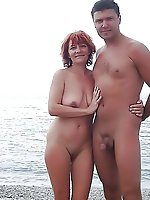 Mature female playing with her twat